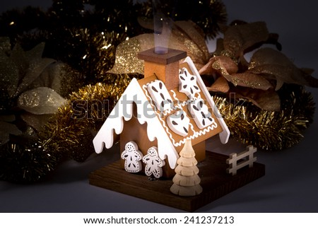 An american home at night during winter. New house , cozy house , smoke from the smoker , heat the house - stock photo