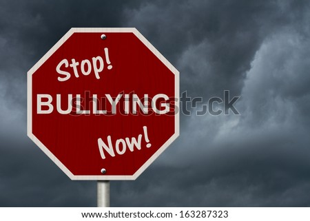 An American road sign and words Stop Bullying Now with stormy sky background, Stop Bullying Now Sign - stock photo