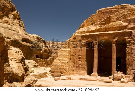 An ancient building carved into the mountain in the Nabatean city of Petra, Jordan. - stock photo