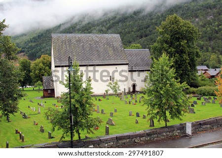 An ancient cemetery in the Norwegian city in the mountains - stock photo