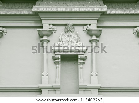 An ancient ornate religious altar on a stonemason wall. - stock photo
