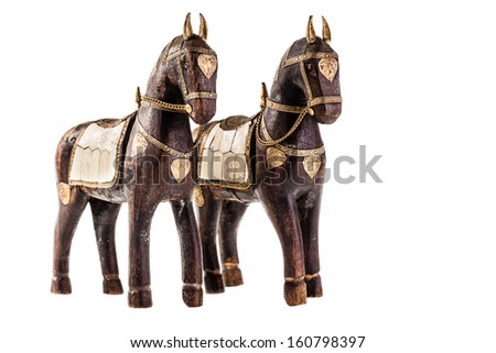 an ancient statuette depicting a horse isolated over a white background - stock photo