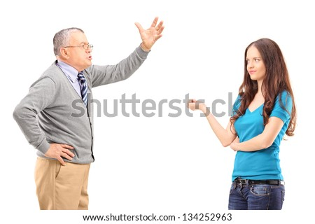An angry father reprimanding his daughter isolated on white background - stock photo