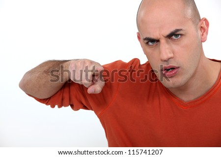 An angry man laying the blame - stock photo