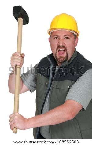 An angry tradesman holding a mallet - stock photo