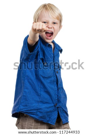 An angry young boy punching and screaming - stock photo