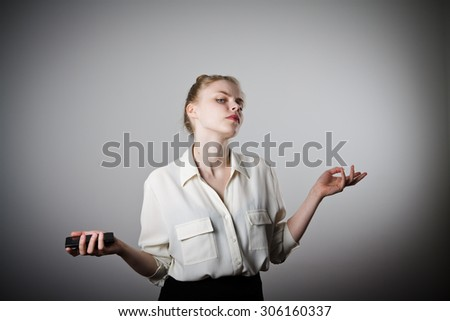 An annoyed and frustrated woman on the phone. Young slim woman. - stock photo