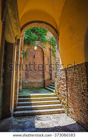 an antique archway in the old town - stock photo