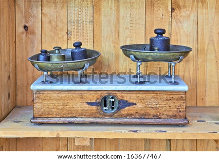 An antique brass and iron scale - stock photo