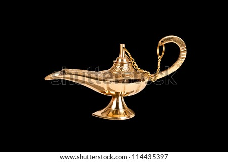 An antique brass oil lamp of genie fame truly isolated on black so designers can easily select it for placement in their projects. - stock photo