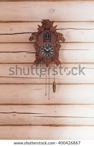 an antique cuckoo clock hanging on the wall - stock photo