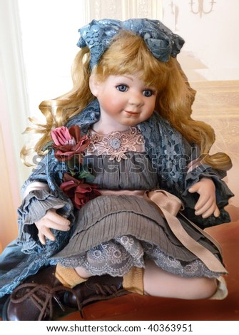 An antique doll - stock photo