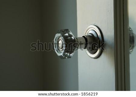 An antique glass doorknob. - stock photo