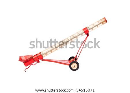 an antique grain auger, farm toy - stock photo