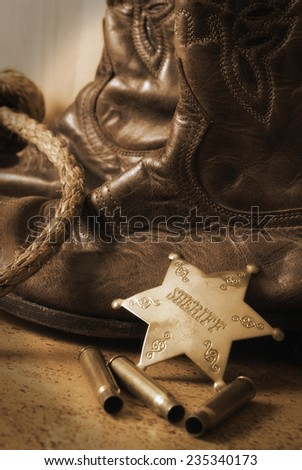 An antique still life on the western sheriff. An antique technique was used and noise has been added to add a realistic effect. - stock photo
