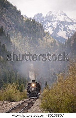 An antique train travels through the Colorado wilderness - stock photo