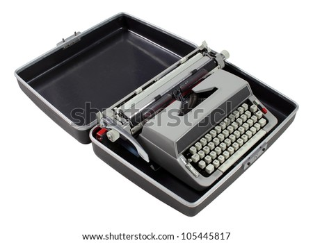 An antique typewriter in protective case on white - stock photo