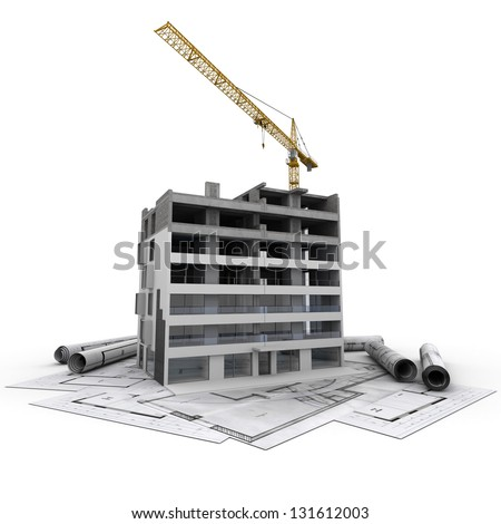 An apartment block in construction with a crane, on top of blueprints - stock photo