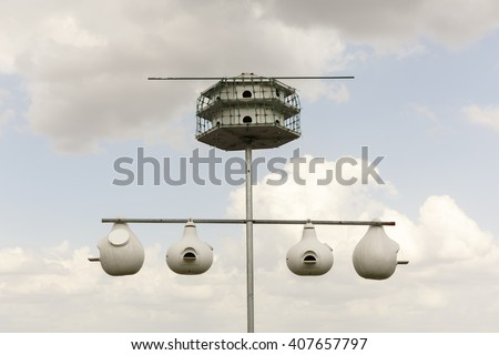 An appartment for bug eating purple martin birds. - stock photo