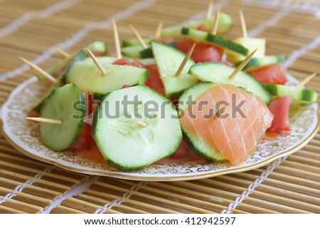 An appetizer with salmon cucumber skewers - stock photo