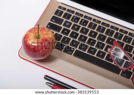 An apple on a computer keyboard - stock photo