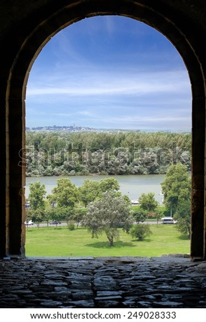 an arch stone Kalemegdan fortress frames the view of the river Danube, Belgrade Old Town - stock photo