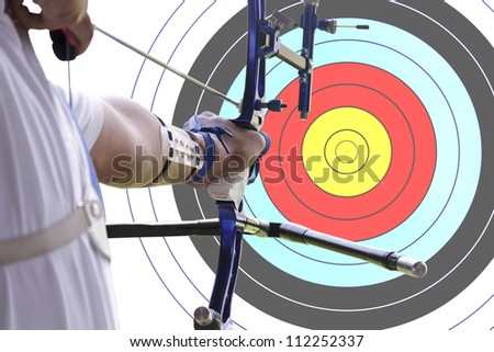 An archer drawing a bow with archery target background. (clipping path) - stock photo