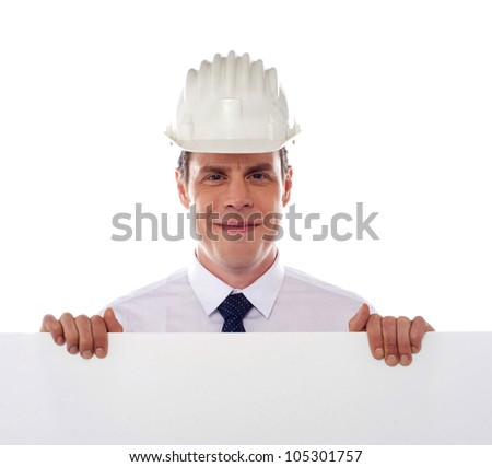 An architect holding blank white placard. All on white background - stock photo