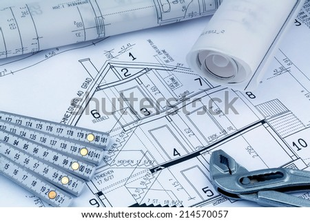 an architect's blueprint for the construction of a new residential house. symbol photo for financing and planning of a new home. - stock photo