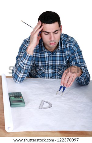 An architect working on his plans. - stock photo