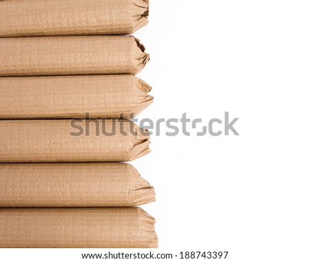 An arrangement of cardboard wrapped products ready to be shipped against a white background. - stock photo