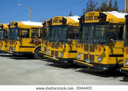 An array of school bus at a local parking lot - stock photo