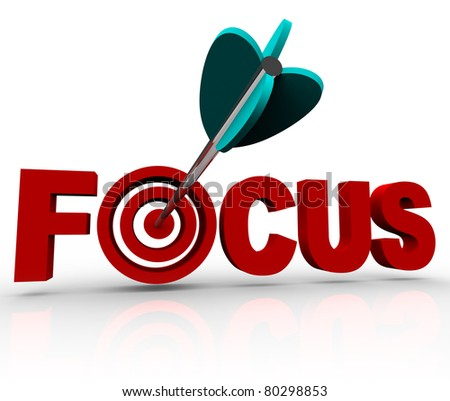 An arrow makes a direct hit in the bulls-eye target in the word Focus, illustrating the importance of focusing and aiming at your goal - stock photo