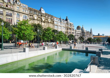 An artificial reservoir on the Avenue of the Allies (Avenida dos Aliados) in Porto, Portugal. Porto is one of the most popular tourist destinations in Europe. - stock photo