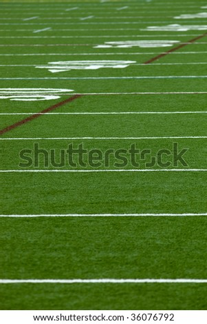 An Artificial turf American football field - vertical - stock photo