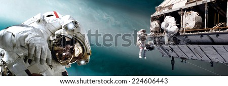 An artist's depiction of  a team of astronauts performing work on a space station while orbiting a large, alien planet. Elements of this image furnished by NASA. - stock photo