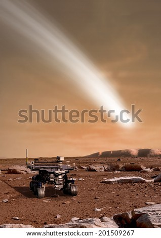 An artist's depiction of the close pass of comet C/2013 A1 over the Martian landscape. Also known as comet Siding Spring. It is scheduled for passage in 2014. Rover image courtesy of NASA. - stock photo