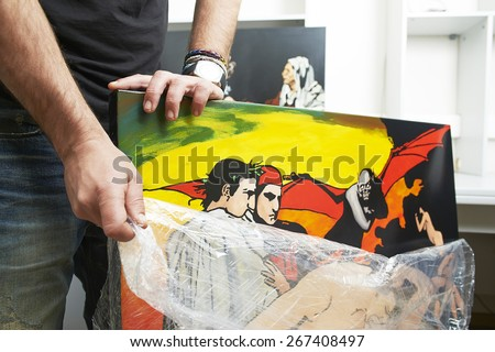 An artist showing his painting - stock photo
