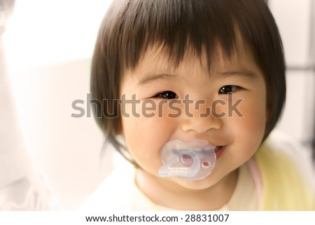 An asia baby was smiling looked so happy. - stock photo