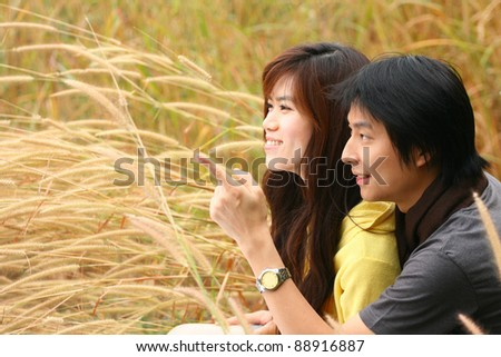 An asian couple point the finger - stock photo
