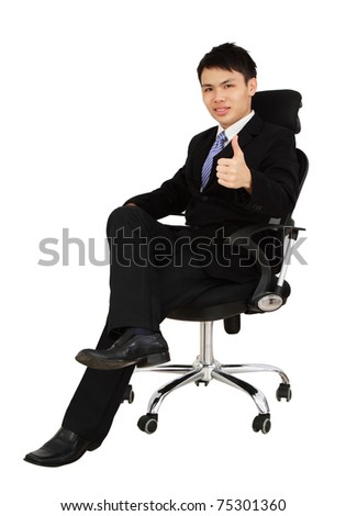 An Asian executive showing thumbs up while sitting on a chair and isolated in white background - stock photo