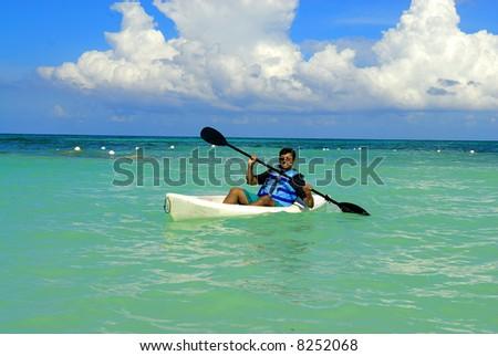 an asian sportsman having fun with his kayak - stock photo