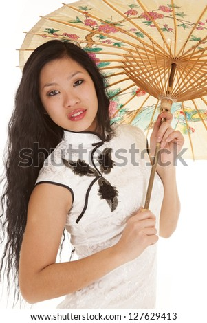 An Asian woman in her traditional dress  and her umbrella in her hands - stock photo