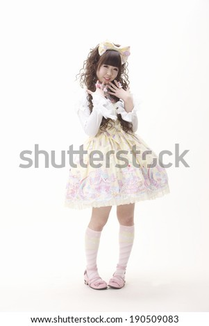 An Asian woman wearing a dress in the Lolita Fashion style, a manifestation of kawaii culture. - stock photo