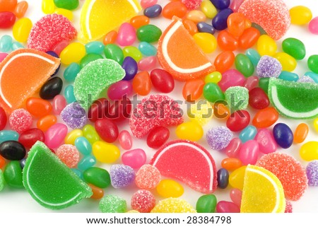 An assortment of colorful candy on full frame background with jellybeans, gumdrops and other jelly candies - stock photo