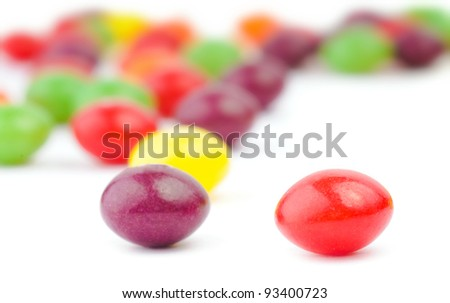 An assortment of colorful candy on white background - stock photo