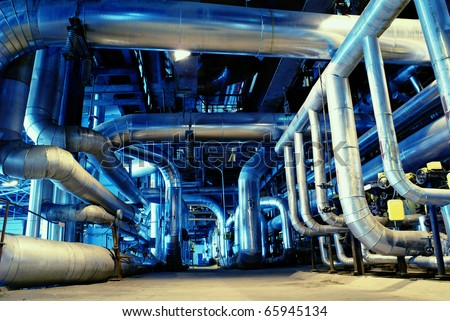 An assortment of different size and shaped pipes at a power plant - stock photo