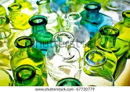 An assortment of empty colorful glass bottles. - stock photo