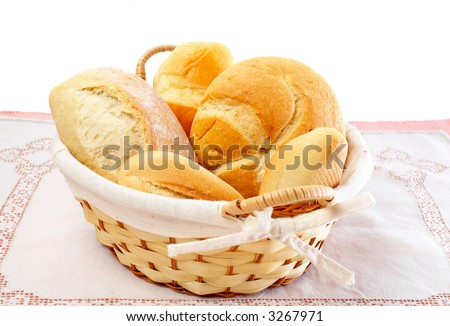 An assortment of fresh breads in a basket - stock photo