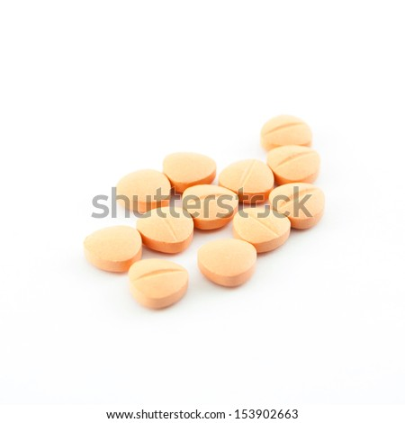 An assortment of pills, tablets isolated on white background - stock photo